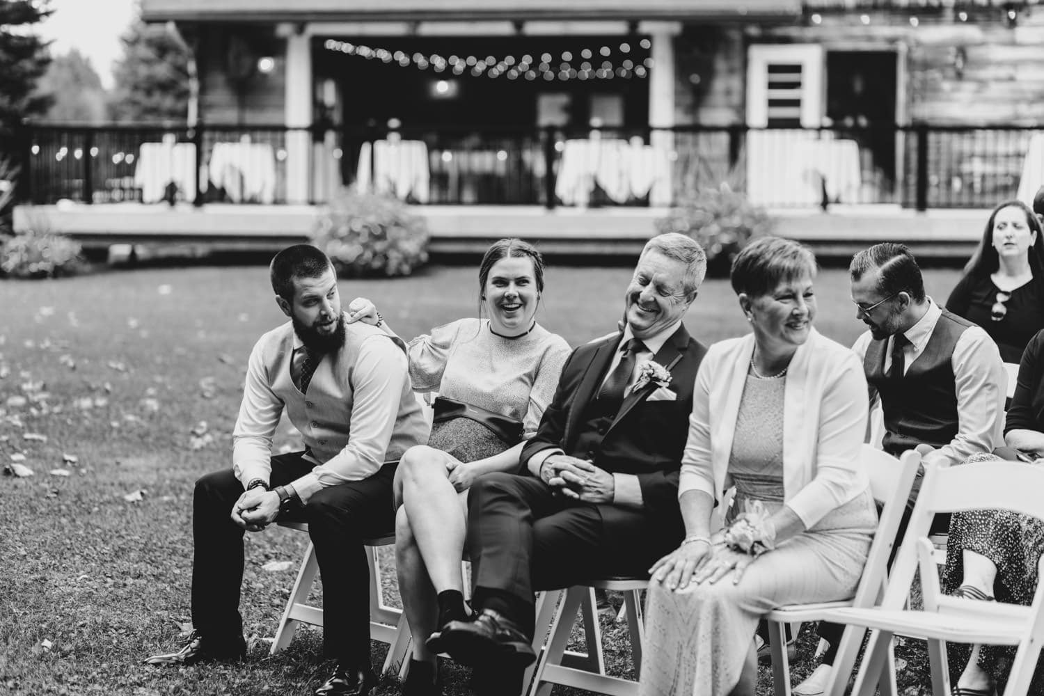 guests laugh while they wait for wedding to start - outdoor wedding ottawa