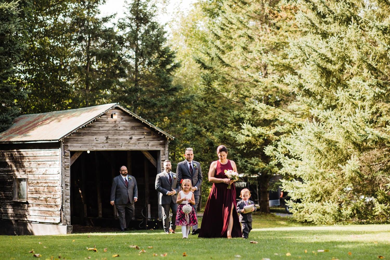 wedding party walks into ceremony - station 4 saisons wedding