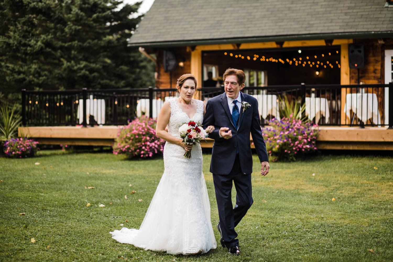 bride takes a deep breath before walking down the aisle - outdoor wedding ottawa