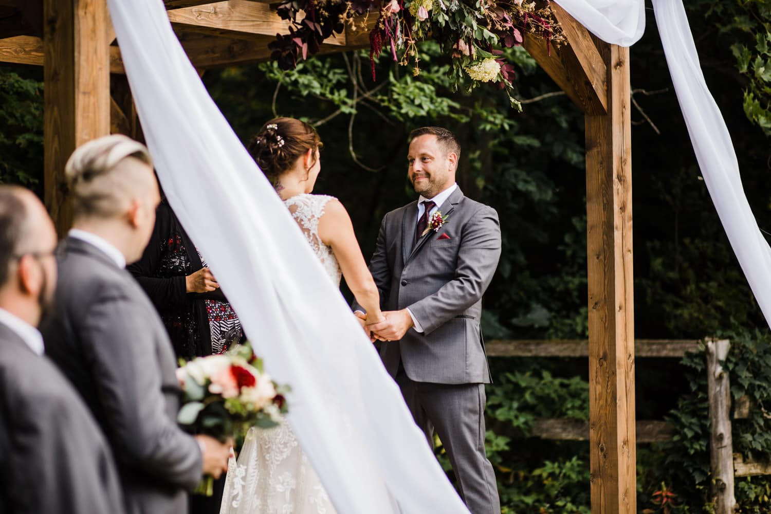groom looks lovingly at bride during wedding ceremony