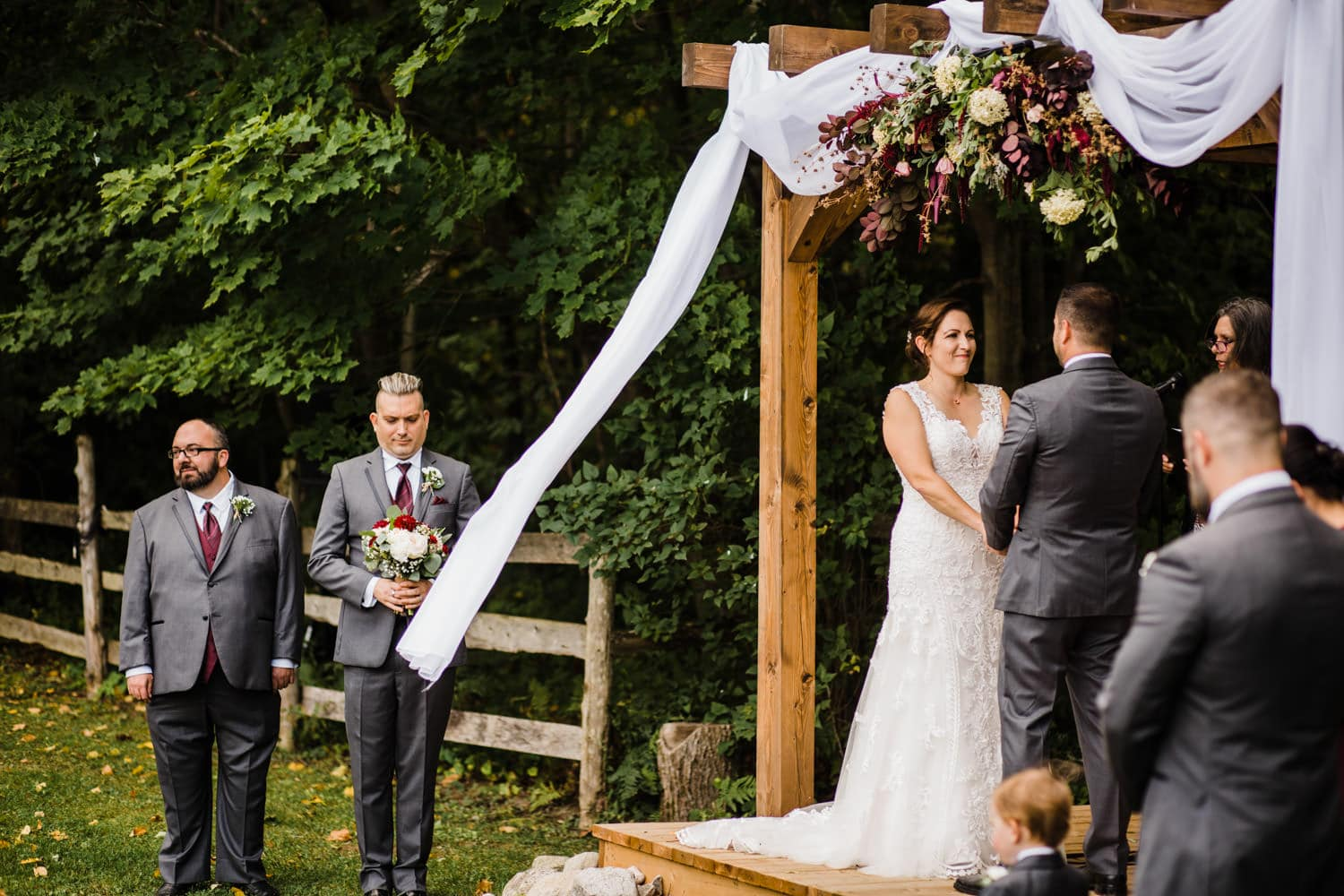 wind blows as couple exchanges their vows - outdoor wedding ceremony ottawa