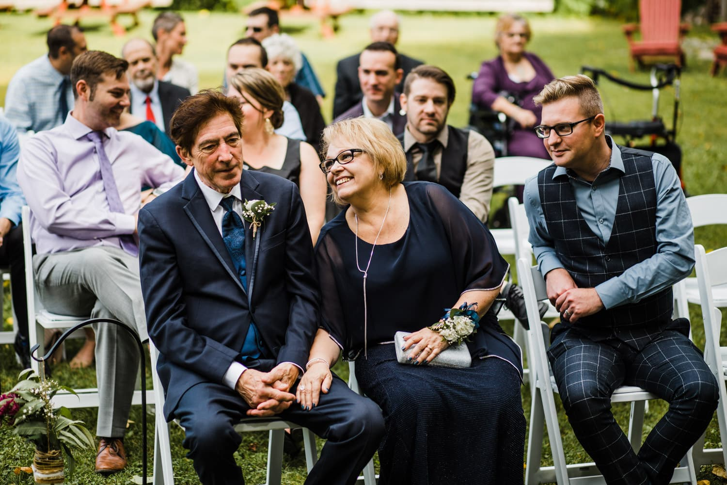 bride's parents laugh during outdoor wedding ceremony - ottawa wedding photographer