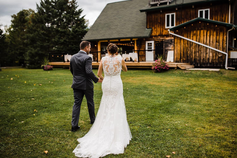 bride and groom walk toward their reception venue - outdoor ottawa wedding