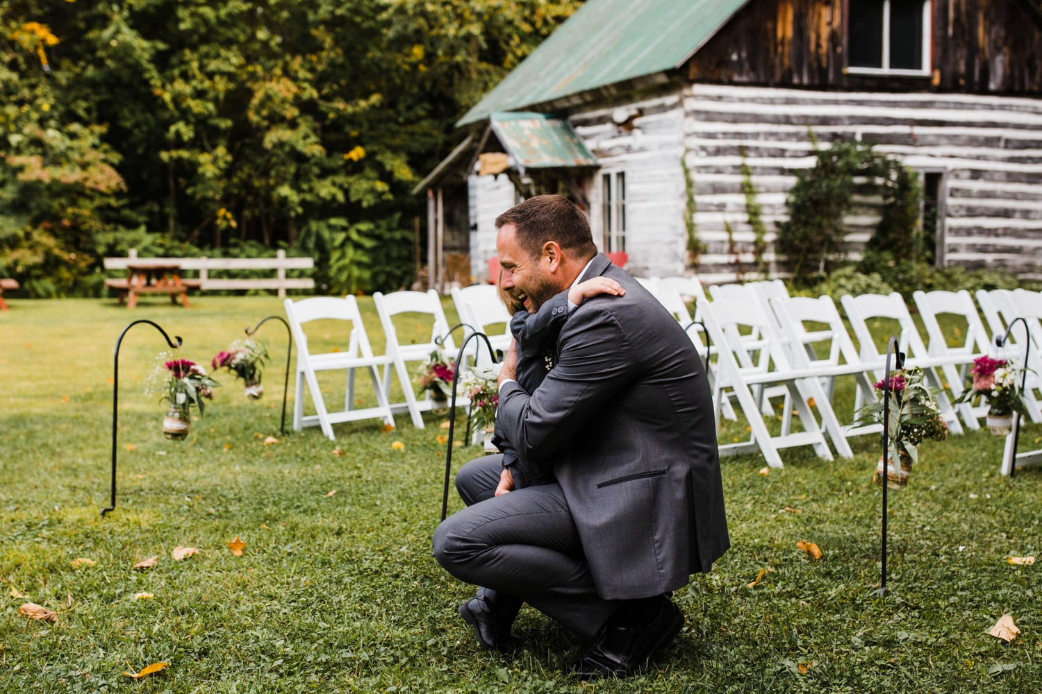 groom hugs his young son