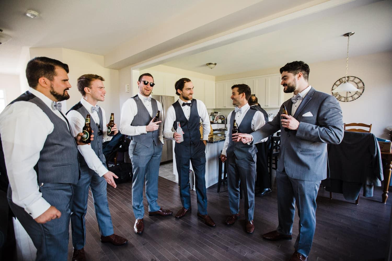 groom gets iced by groomsmen