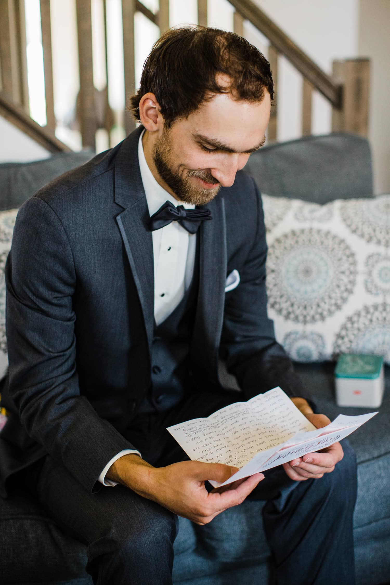 groom reads letter from his bride