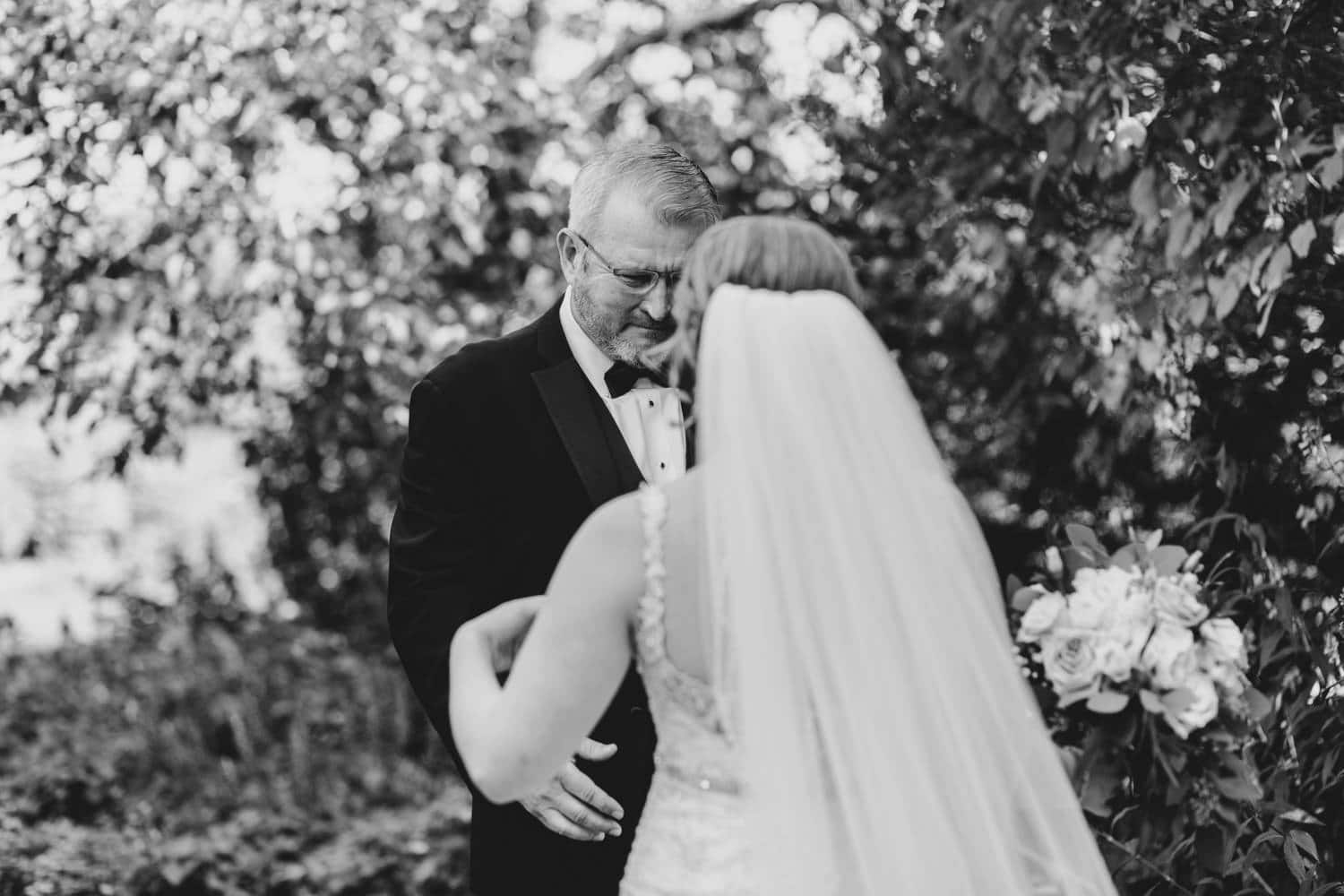 father cries during first look with his daughter on her wedding day