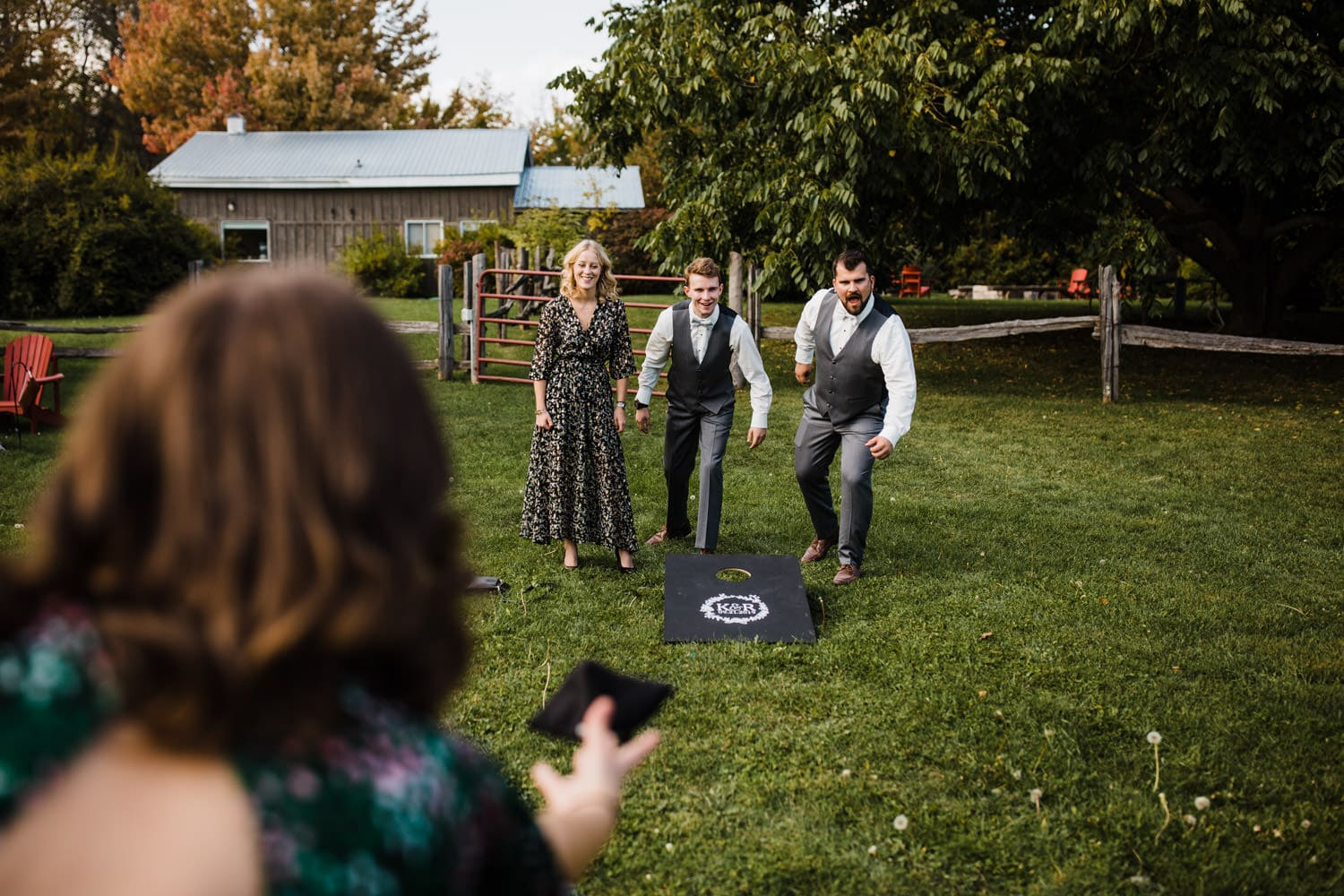 guests play lawn games - strathmere summer wedding