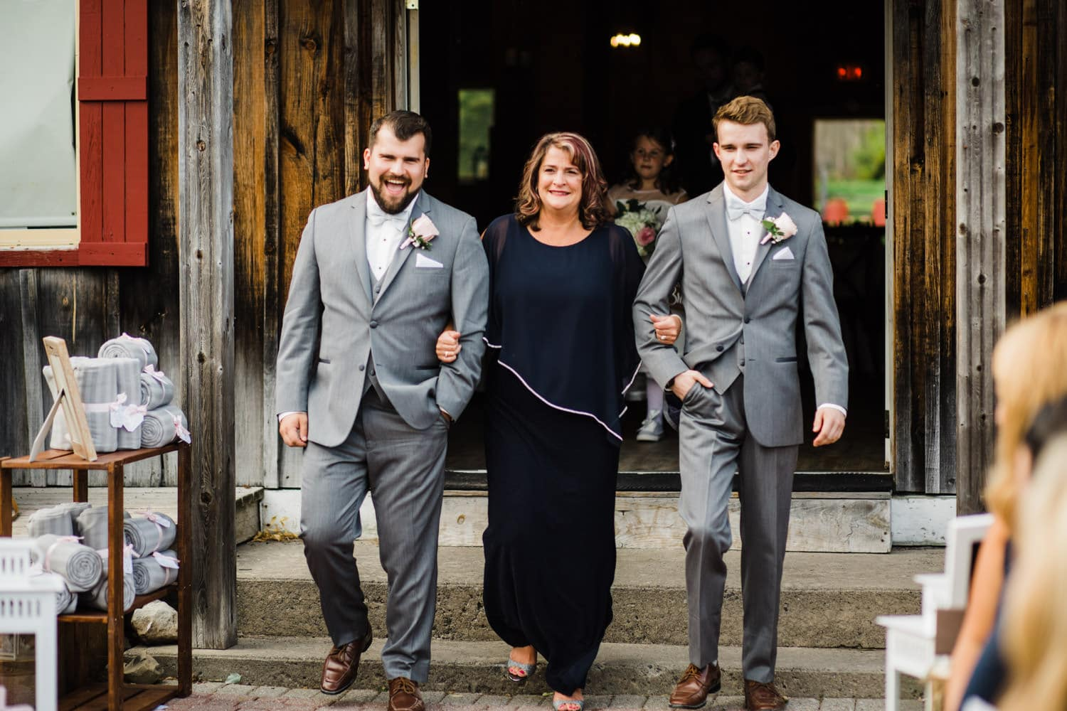 mother of the bride walks down the aisle