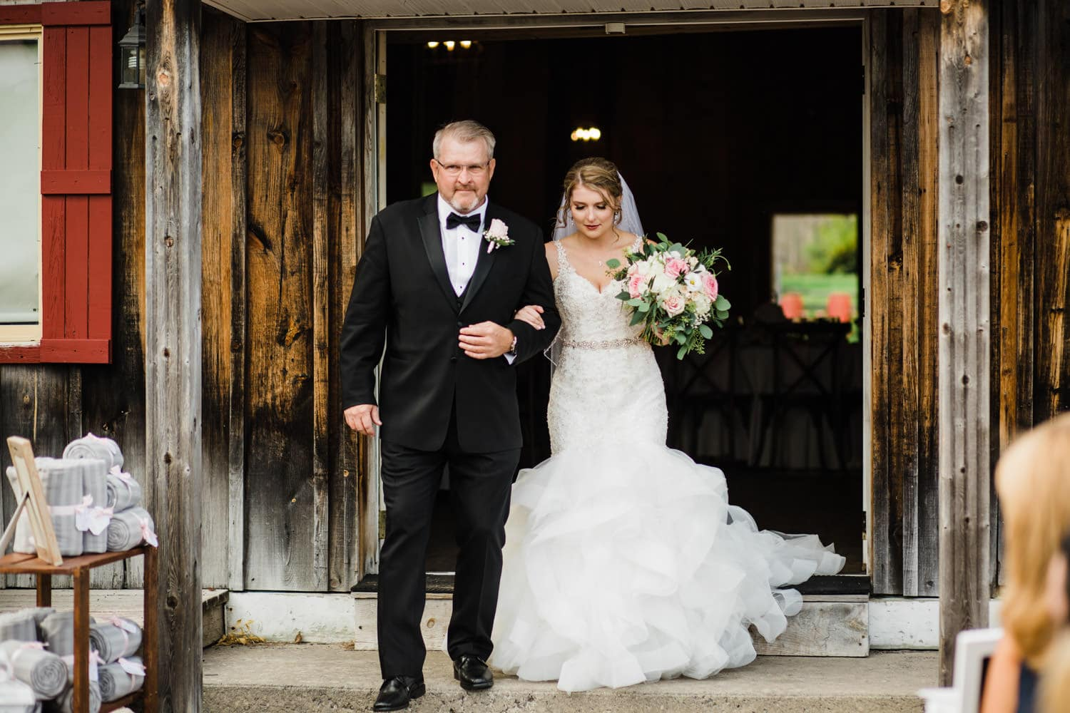 bride walks down the aisle at the lodge - strathmere
