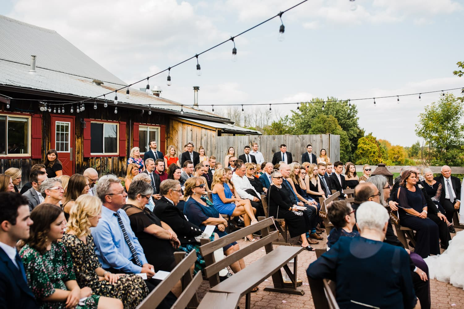 guests watch wedding ceremony at the lodge - strathmere summer wedding