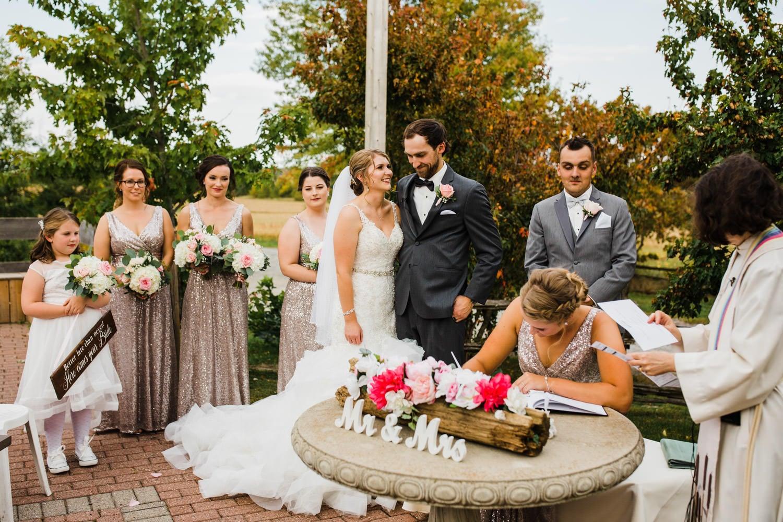 signing the registry - outdoor summer wedding