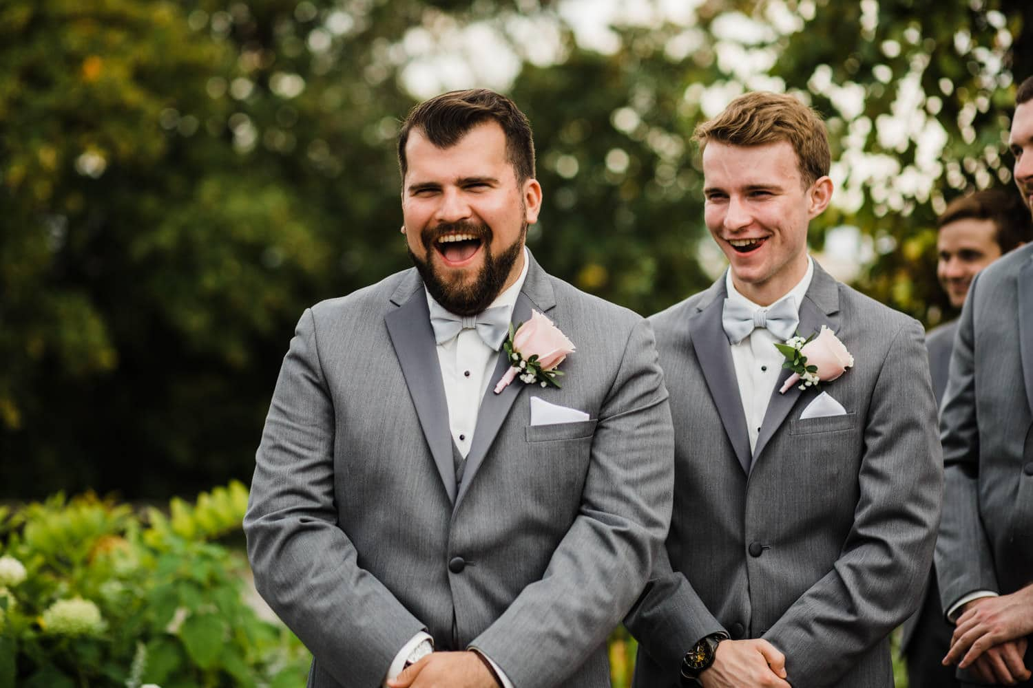 groomsmen laugh during ceremony - outdoor summer wedding