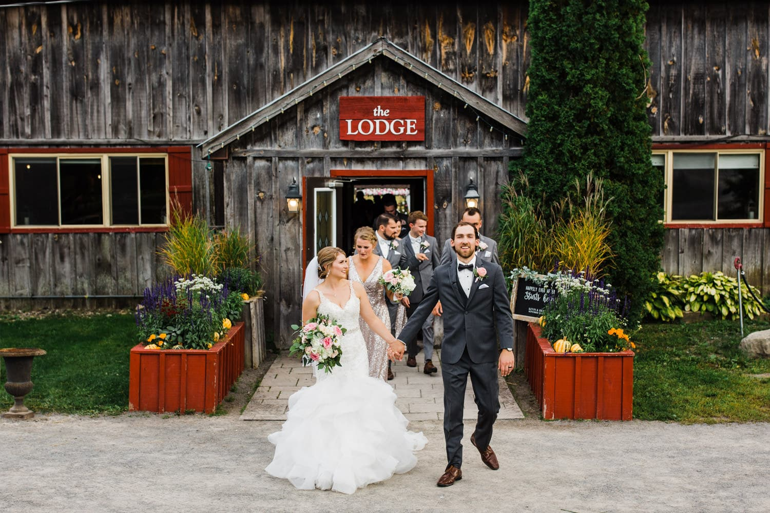 bride and groom walk out of lodge after ceremony - summer strathmere wedding