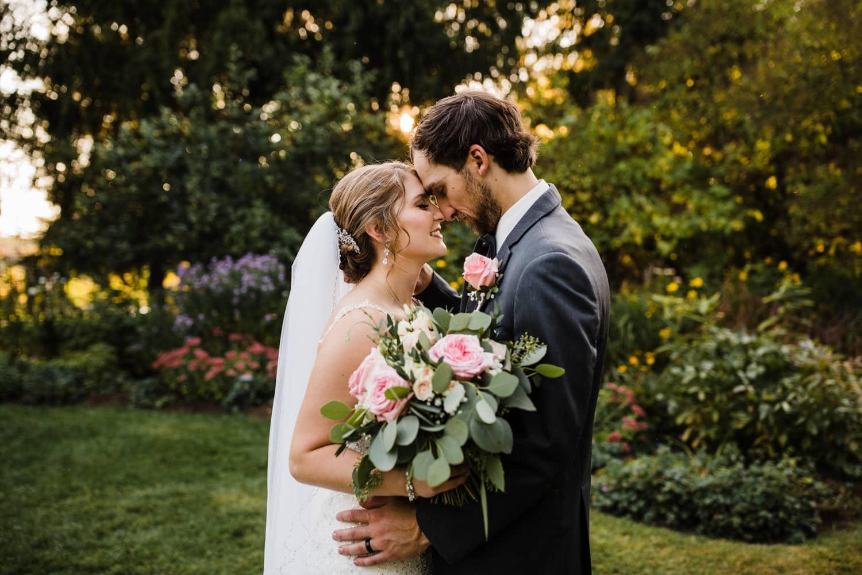 bride and groom stand close during sunset together - summer strathmere wedding