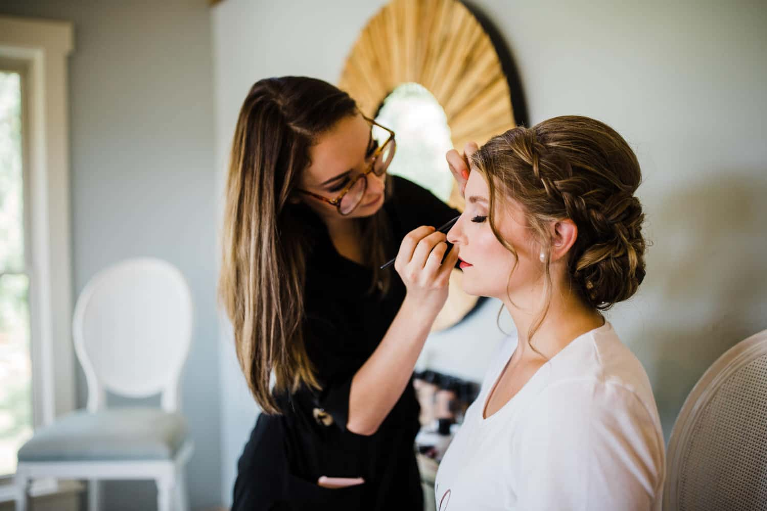 bride has her makeup done at strathmere retreat