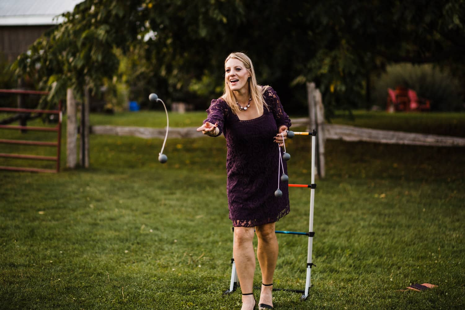 guests play lawn games during wedding reception