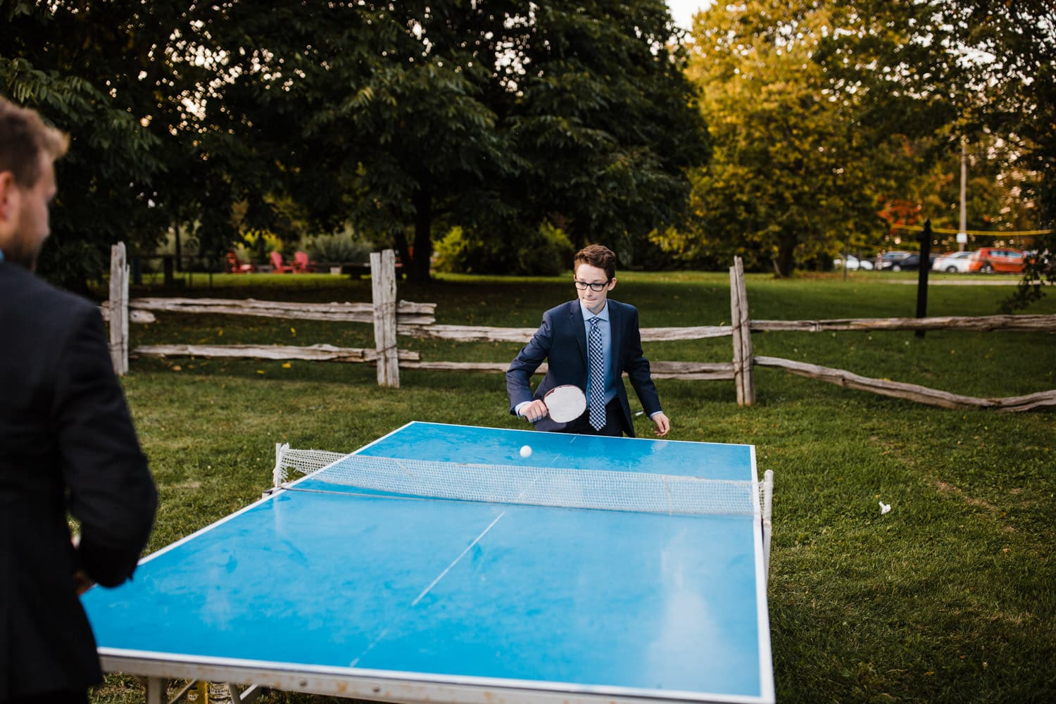 guests play ping pong during cocktail hour