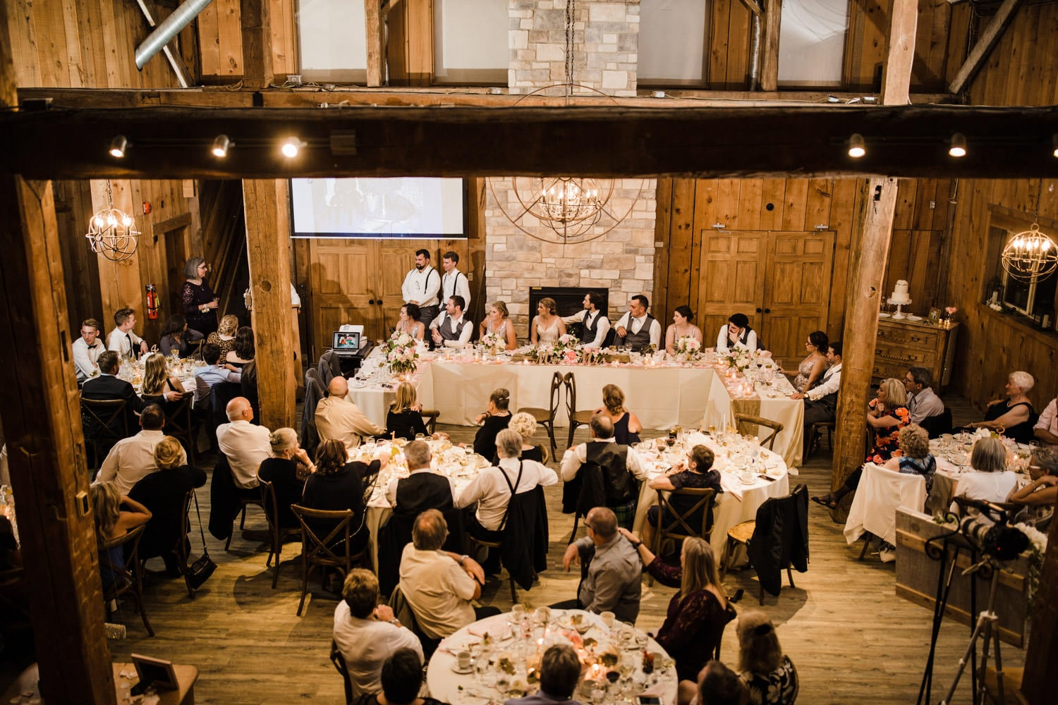 wide view of guests and head table during dinner - strathmere summer wedding