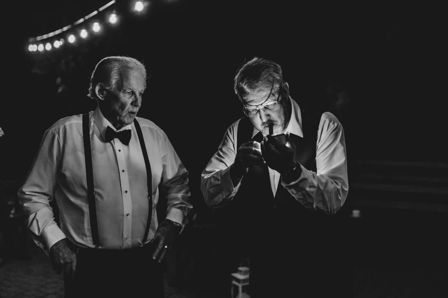 bride's father lights up a cigar outside - strathmere summer wedding