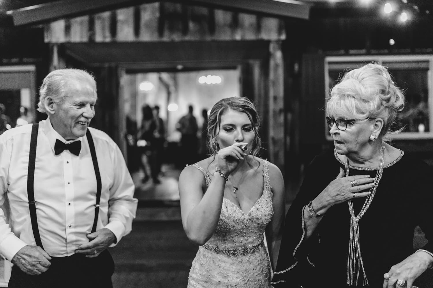 bride smokes a cigar with her grandparents - strathmere summer wedding