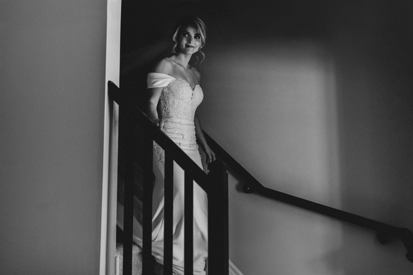 bride walks down stairs in her gown - ottawa wedding photographer