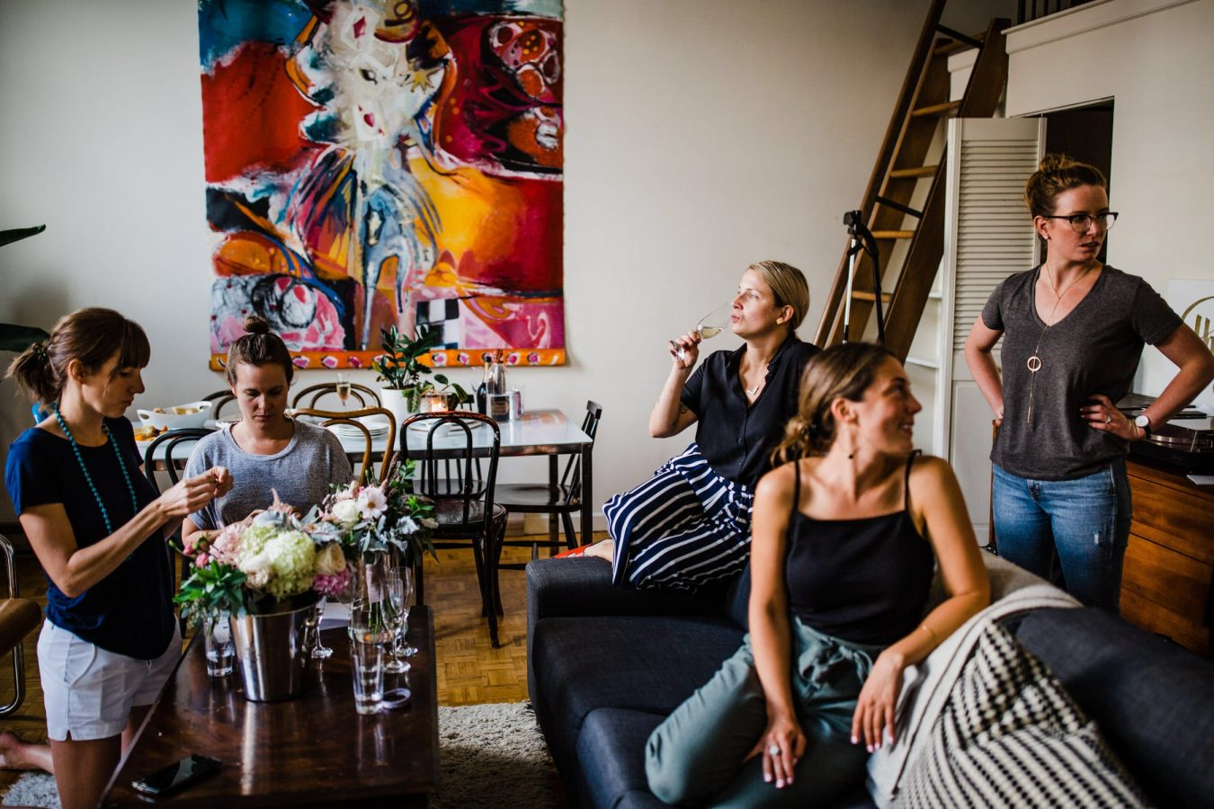ladies hang out in loft during bridal prep - ottawa wedding photographer