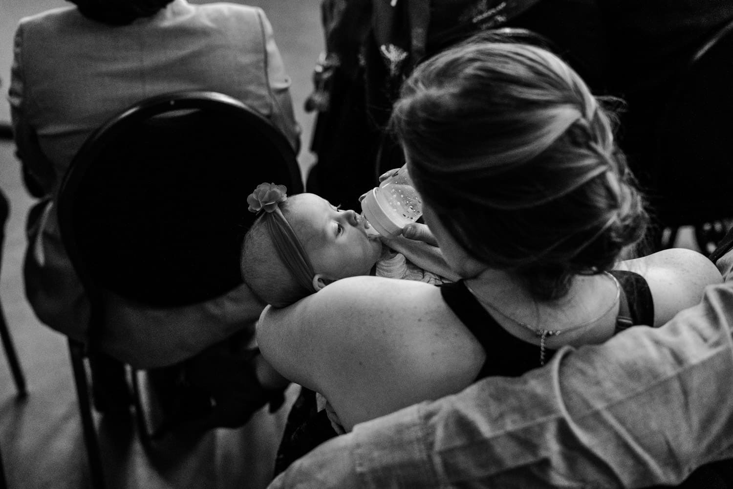 guests feeds a baby during wedding ceremony