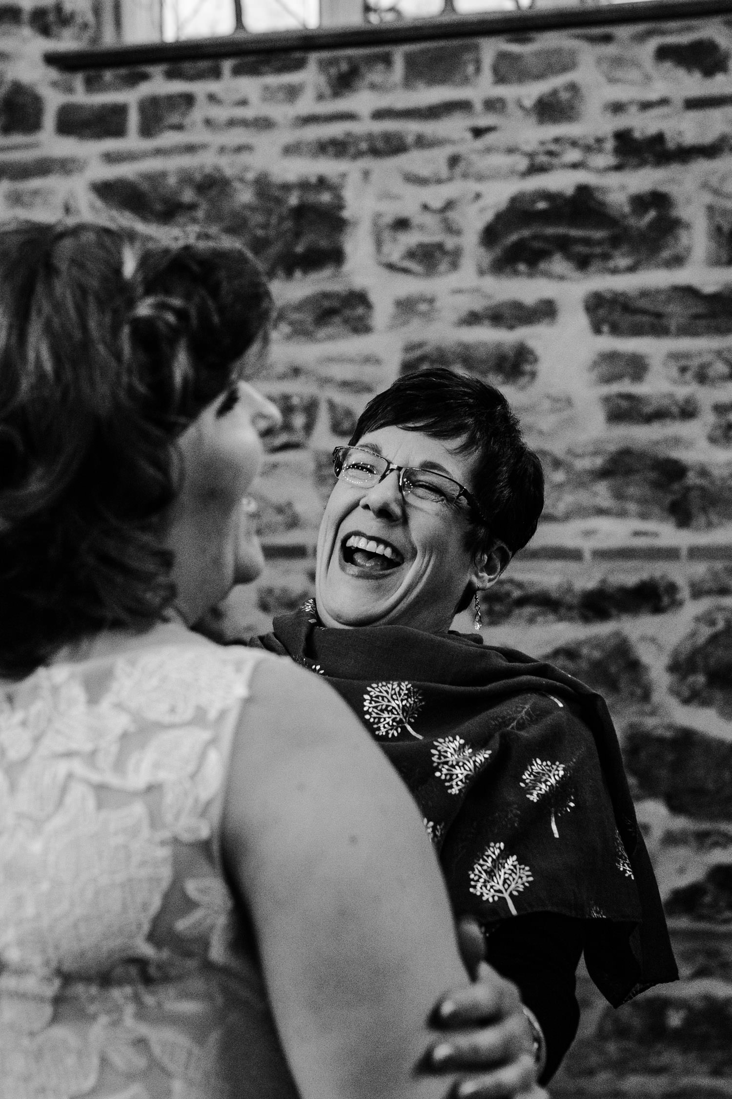 guests laugh with bride after ceremony