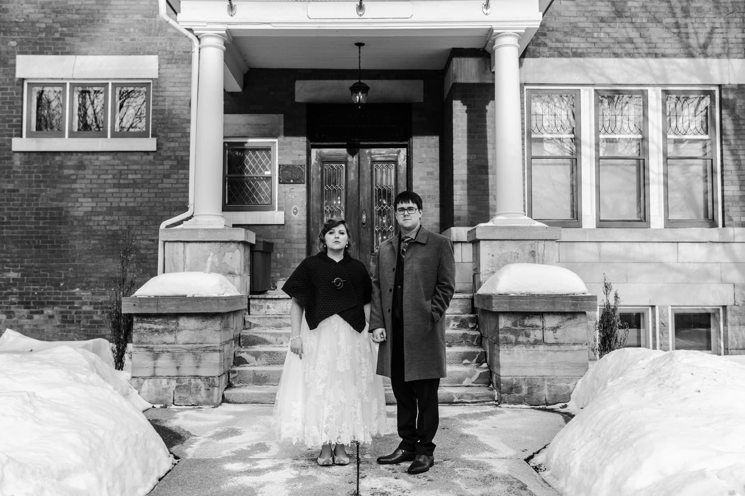 bride and groom pose outside at winter wedding ottawa