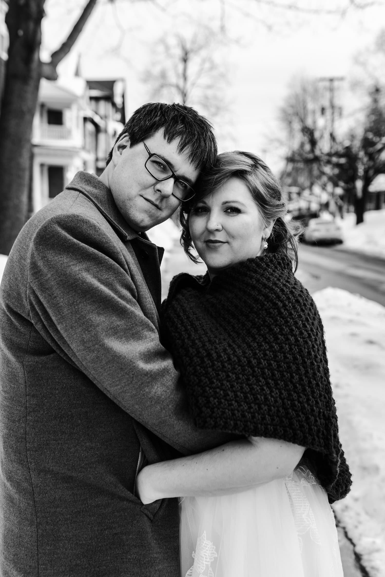 bride and groom pose outside - ottawa winter wedding