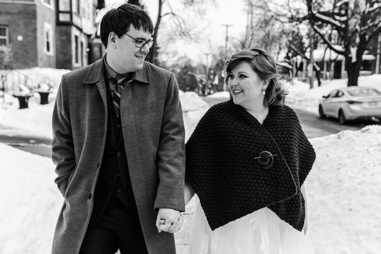 bride and groom walk together outside - ottawa winter wedding