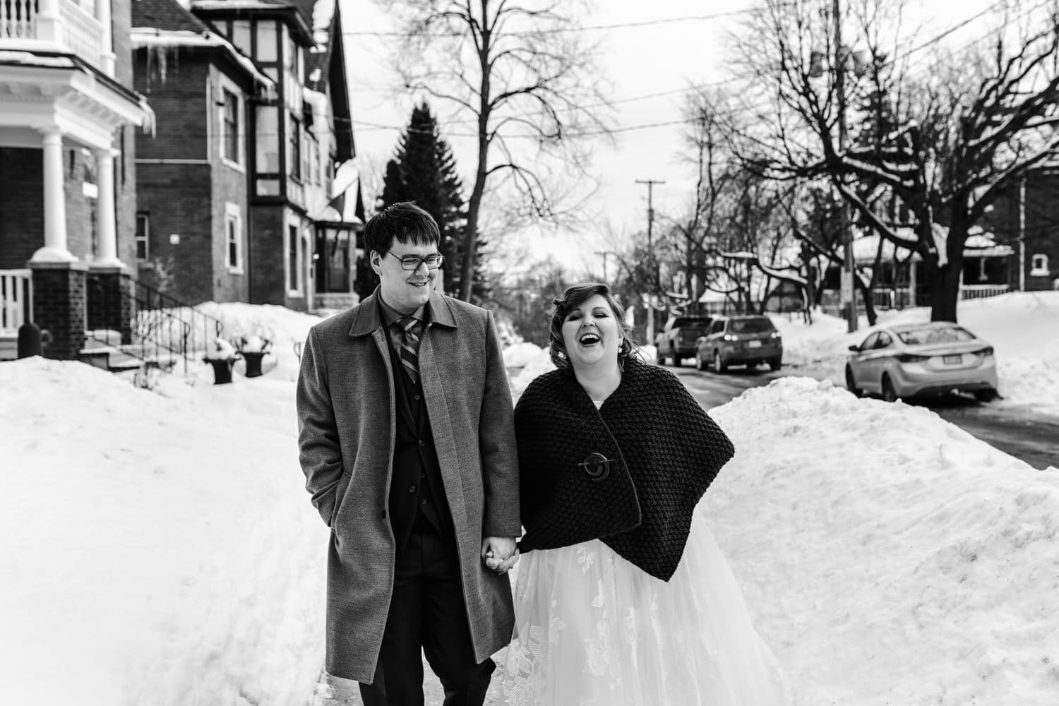 bride and groom laugh together outside - intimate winter wedding