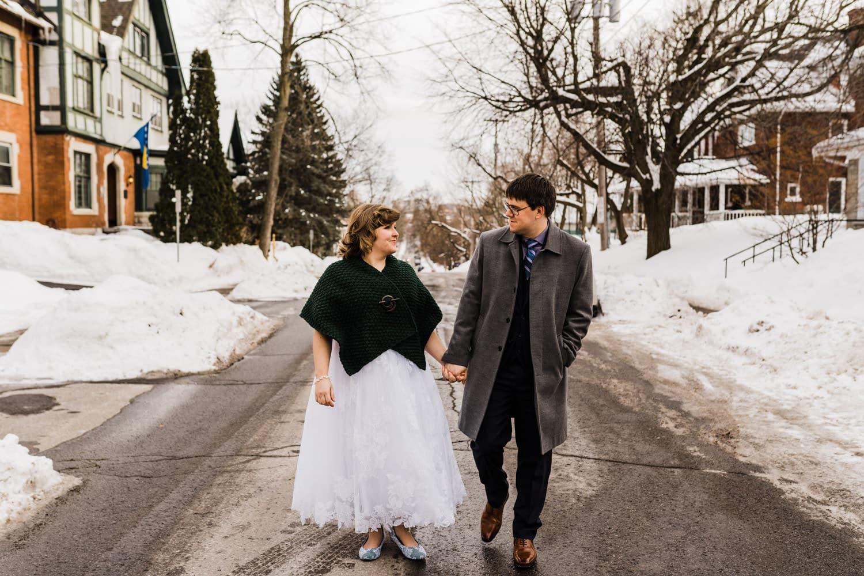 bride and groom walk outside together - ottawa winter wedding