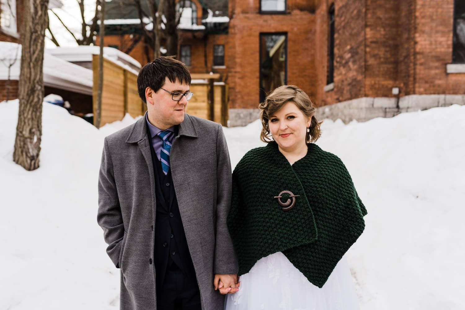 bride and groom stand outside together - ottawa winter wedding