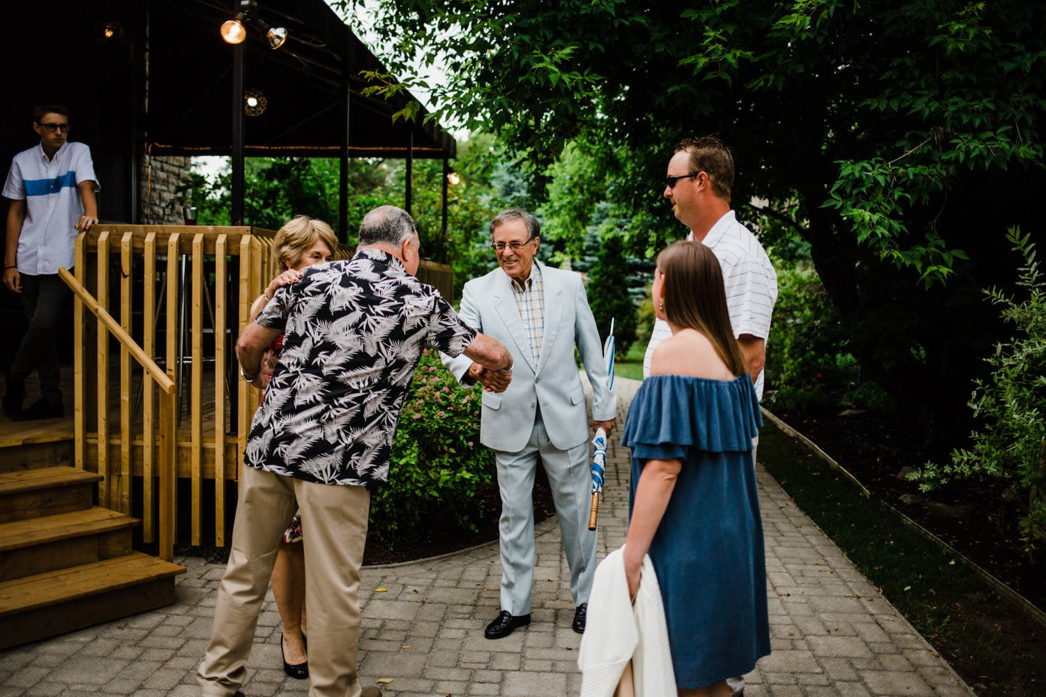 guests greet one another - small wedding at the schoolhouse