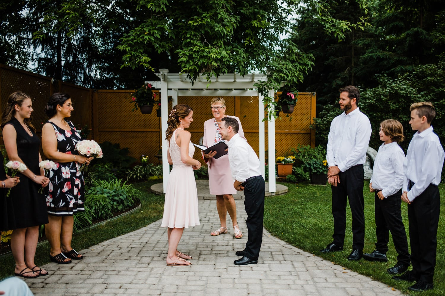 bride and groom laugh while exchanging vows - small outdoor ottawa wedding