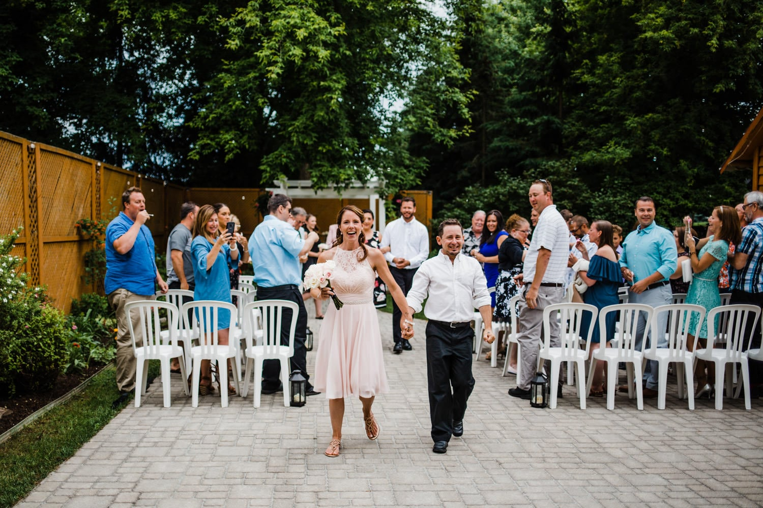 bride and groom wedding recessional - small ottawa wedding at the schoolhouse