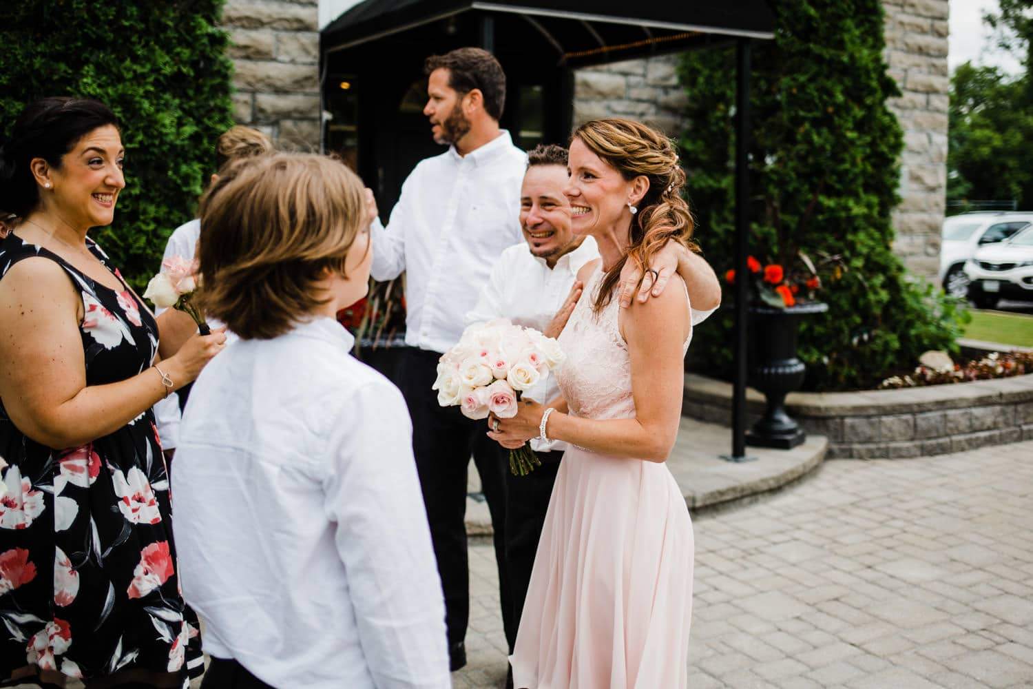 bride and groom celebrate after the ceremony - small outdoor ottawa wedding