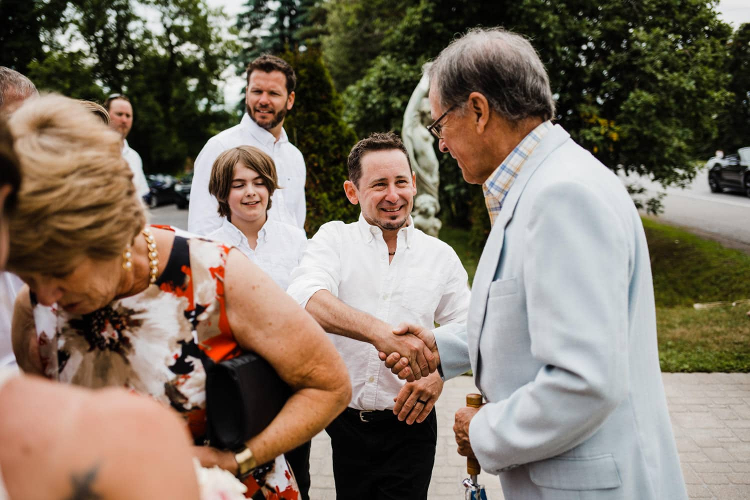 groom mingles with guests after the ceremony - intimate wedding at the schoolhouse