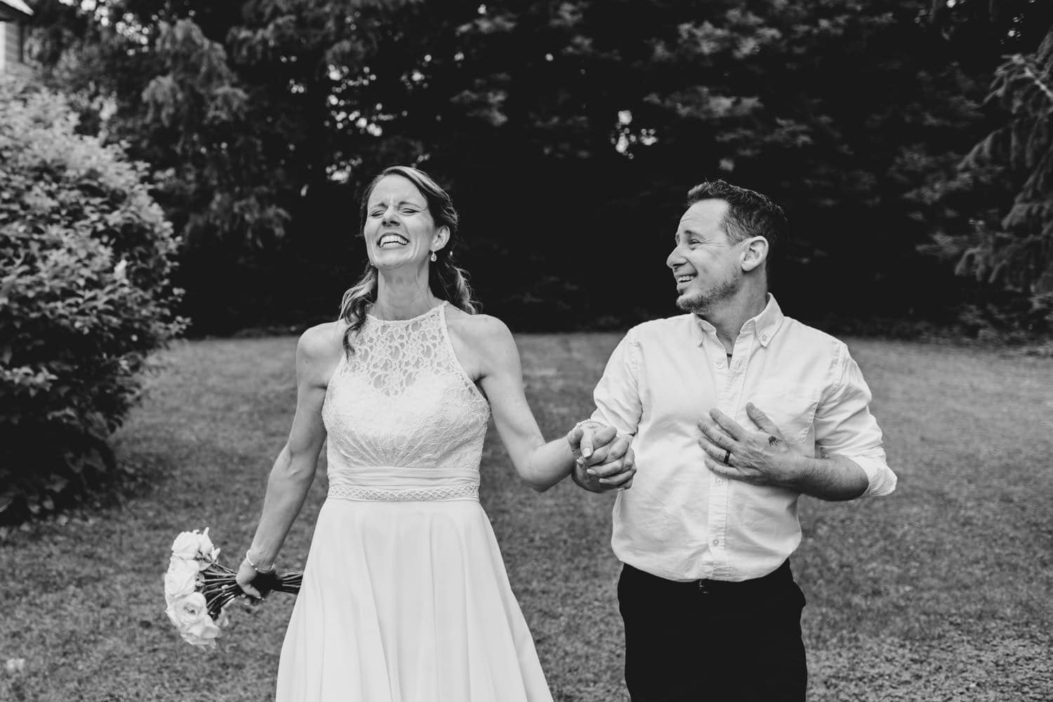 bride and groom laugh together after the ceremony - small outdoor wedding at the schoolhouse