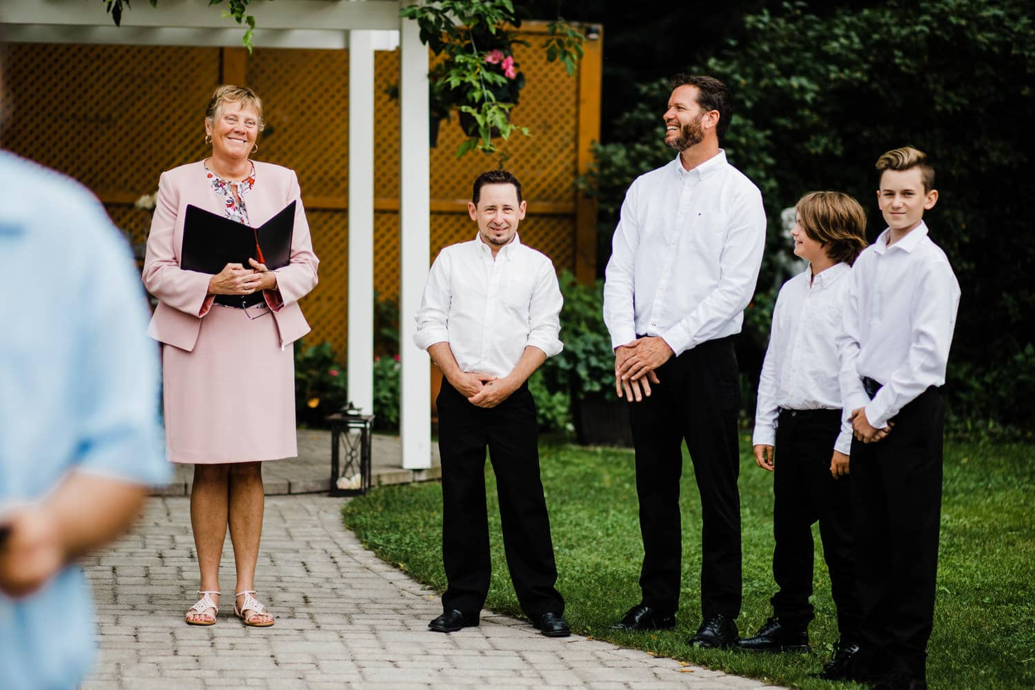 groom sees bride at the end of the aisle - small wedding at the schoolhouse