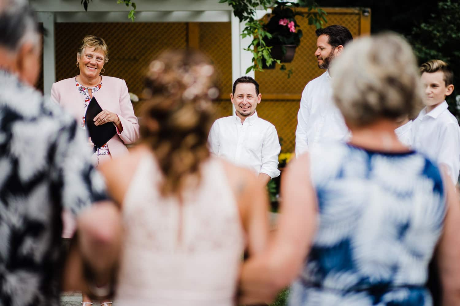 groom sees bride coming down the aisle - small outdoor wedding ottawa