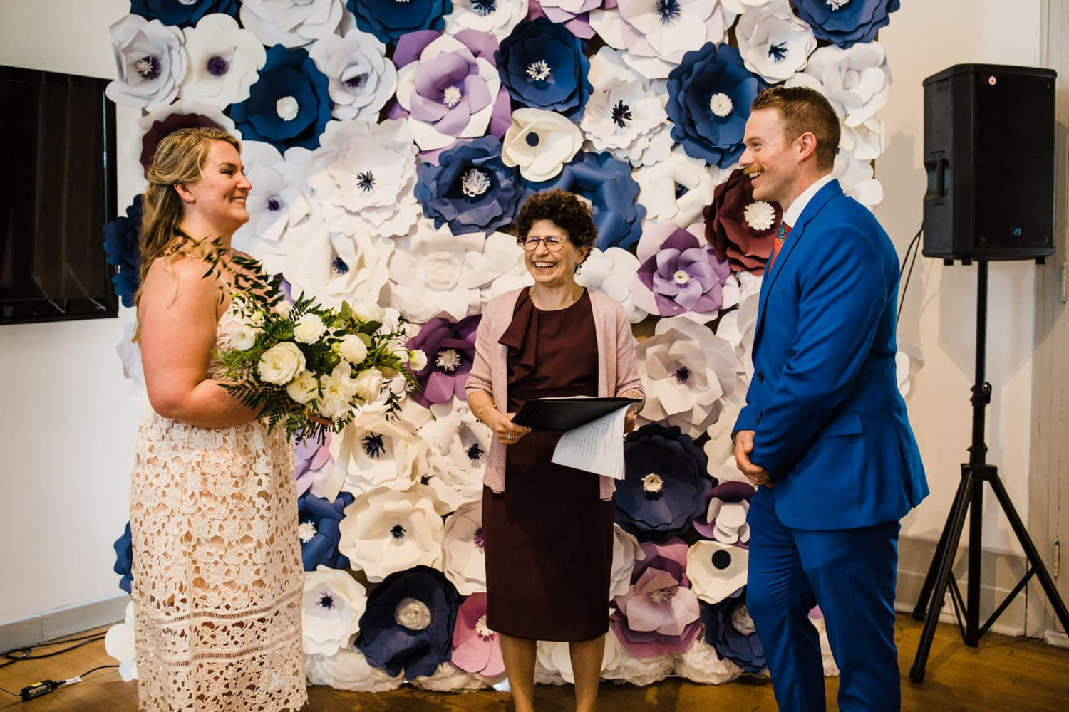 bride and groom laugh during intimate wedding ceremony