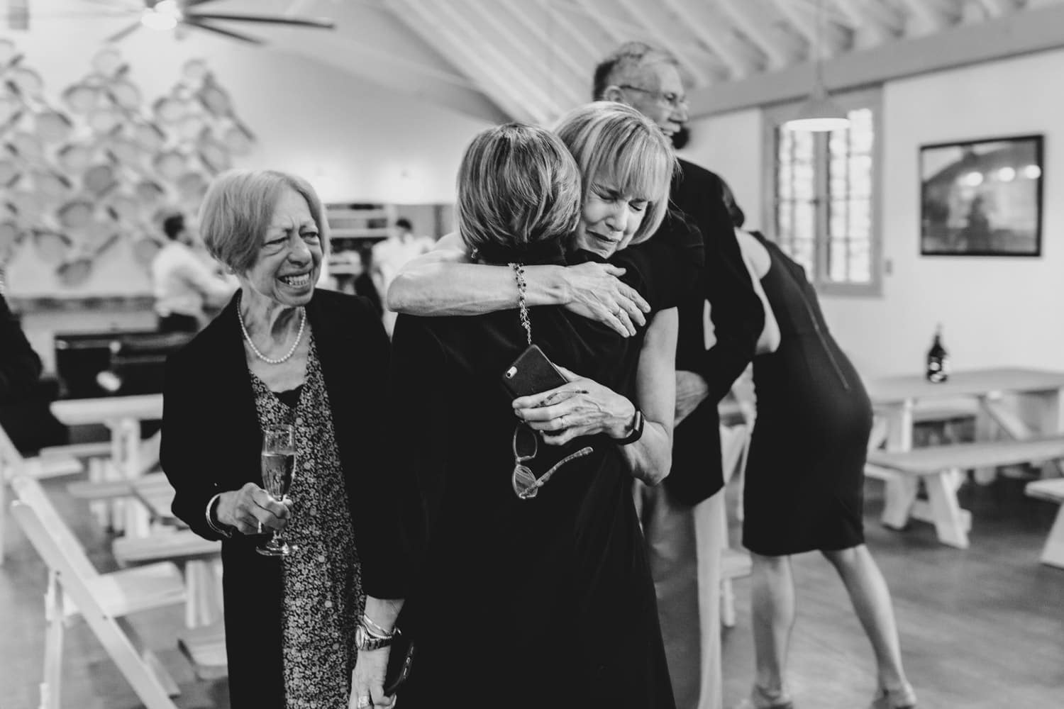 guests hug and cry after the ceremony - small wedding at The Cameron Ottawa
