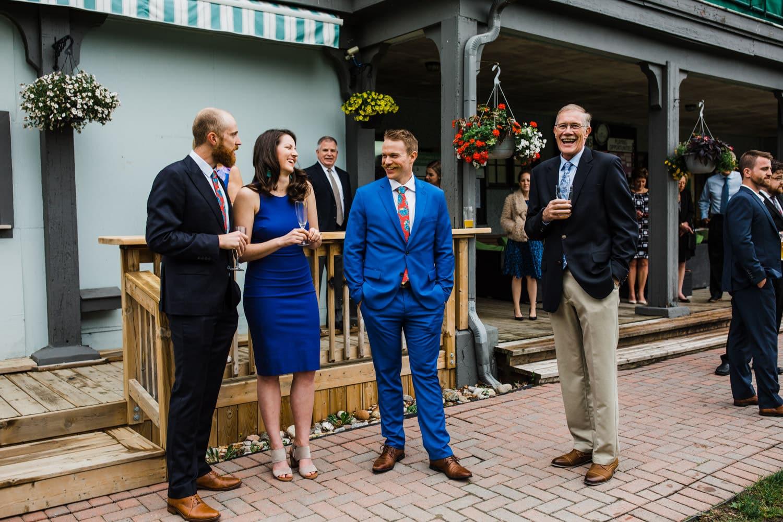 guests mingle and laugh at small wedding at The Cameron Ottawa