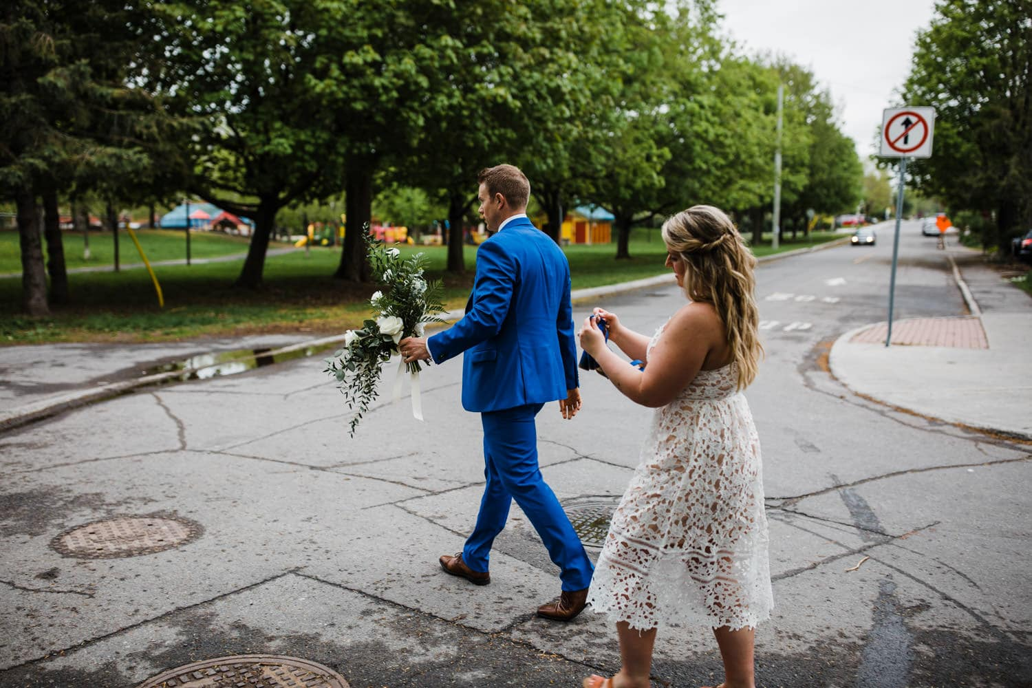 bride and groom walk on the street together - small ottawa wedding The Cameron