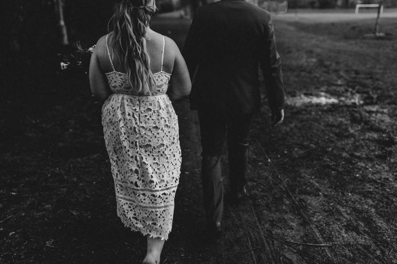 bride and groom walk on rainy wedding day - small Ottawa wedding The Cameron