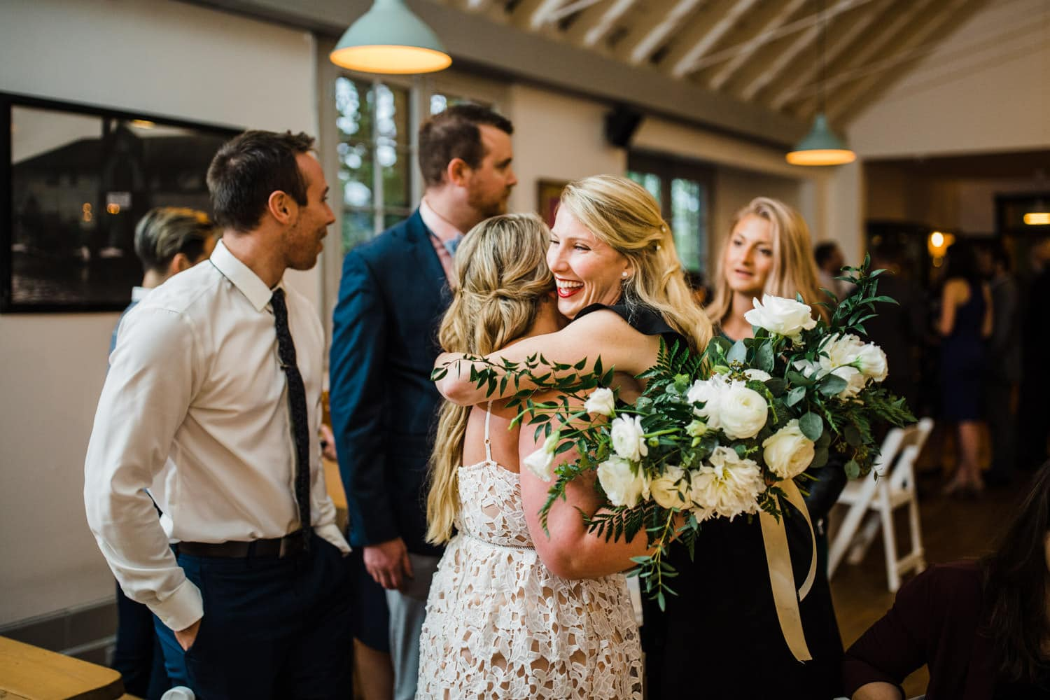 bride hugs her friends - small ottawa wedding at The Cameron