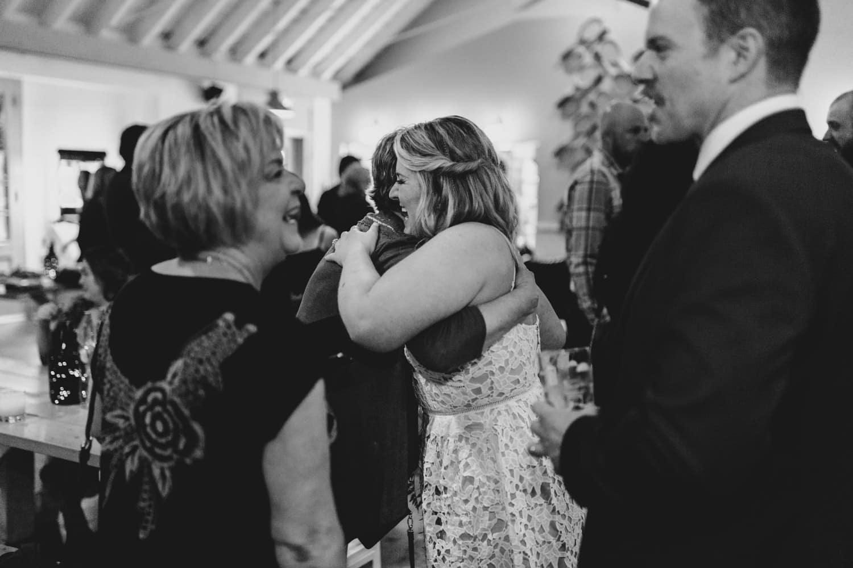 bride hugs guests - small ottawa wedding